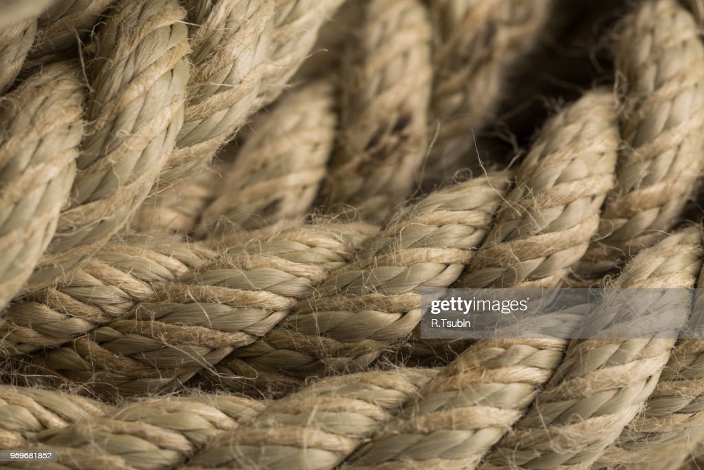 Close-up of an old frayed boat rope as a background : Stock Photo