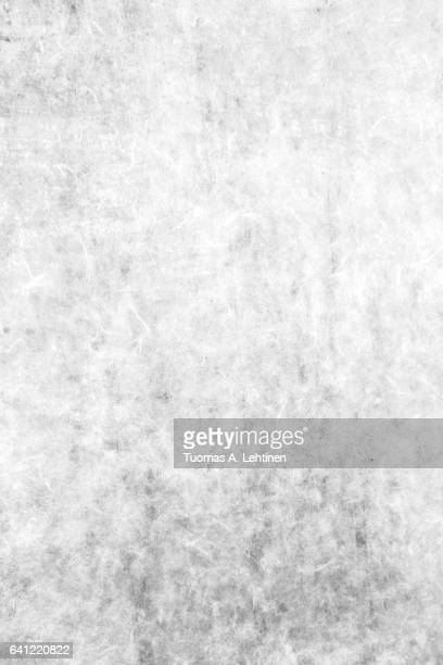 Close-up of an old paper wall texture background in black&white.