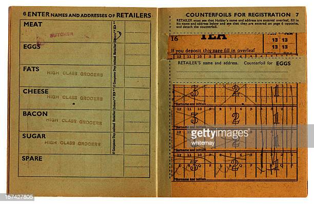 closeup of an old, used british ration book opened up.  - rationing stock photos and pictures