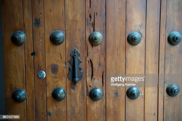 Closeup of an old wooden door in Oaxaca City Mexico