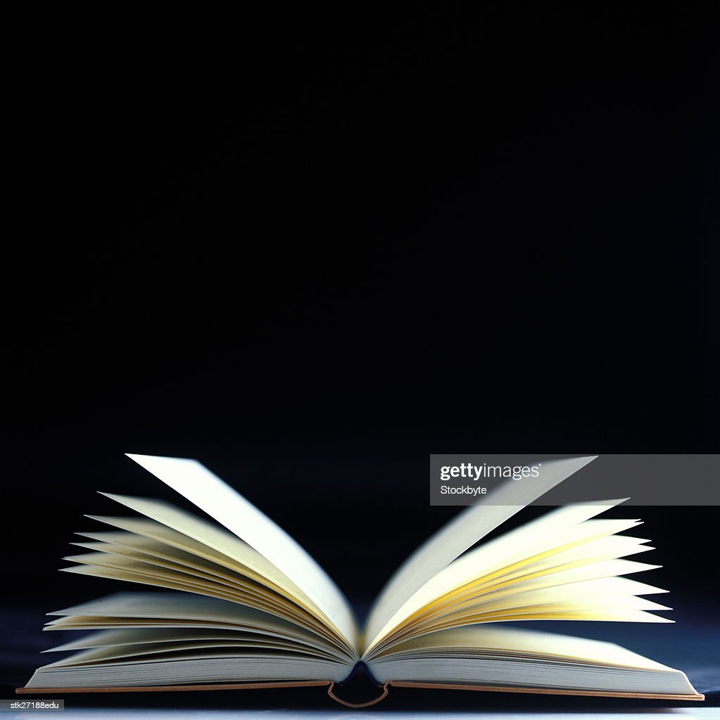 close-up of an open book with pages flying : Stock Photo