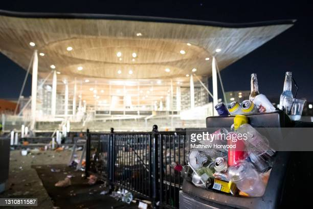 Close-up of an overflowing bin as rubbish is left on the floor following a party outside the Senedd, home of the Welsh Parliament, in Cardiff Bay on...