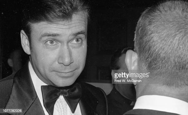 Closeup of an unidentified man as he speaks with American attorney Roy Cohn at Cohn's birthday party at the Seventh Regiment Armory New York New York...