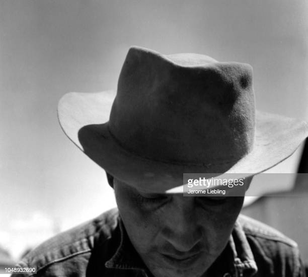 Closeup of an unidentified man on the Blackfeet Indian Reservation Browning Montana 1963 He wears a cowboy hat his head and eyes tipped downward