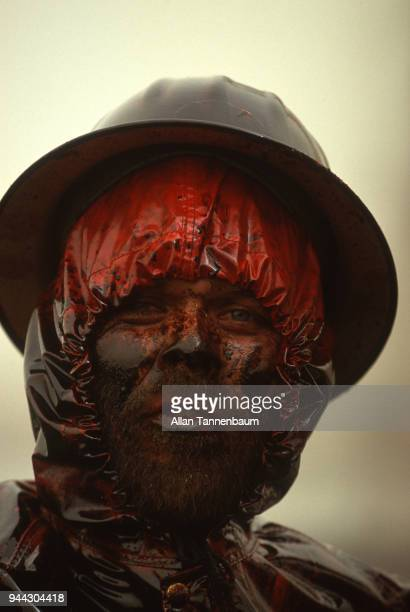 Closeup of an unidentified oil worker covered in residue from a well blowout during the Operation Desert Storm Kuwait 1991