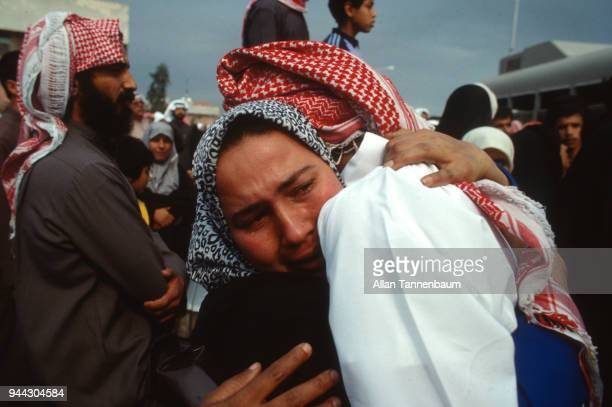 Closeup of an unidentified woman who cries as she hugs to another woman Kuwait 1991