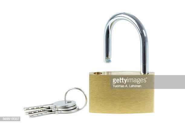 Close-up of an unlocked padlock and keys