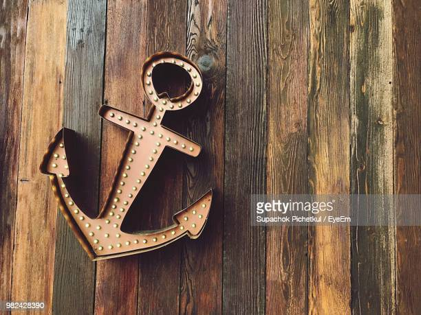 Close-Up Of Anchor On Wooden Table