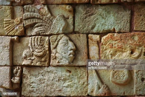 closeup of ancient mayan carving, copan, honduras - maya artifacts stock pictures, royalty-free photos & images