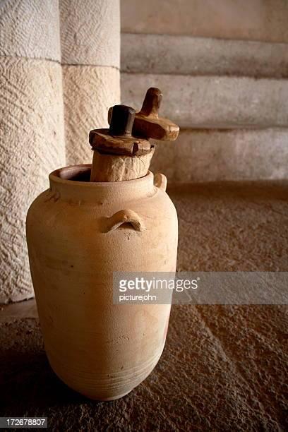 Close-up of ancient scrolls inside an ancient jar