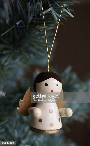 Close-Up Of Angel Hanging On Christmas Tree