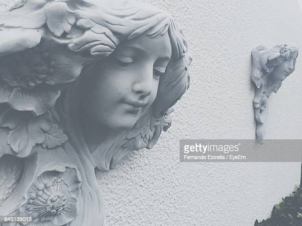 Close-Up Of Angel Sculpture On Wall