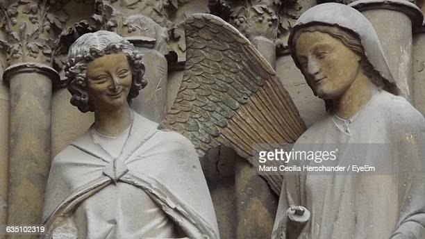 close-up of angel statues at reims cathedral - cathedral stock pictures, royalty-free photos & images