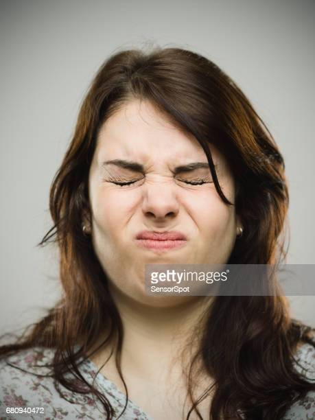 Close-up of angry woman puffing cheeks