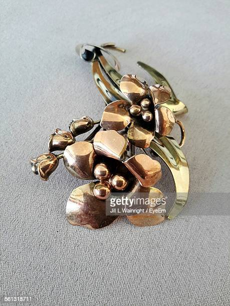 Close-Up Of Antique Brooch On Table