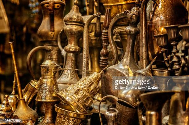 close-up of antique containers for sale at shop - jerusalem stock pictures, royalty-free photos & images