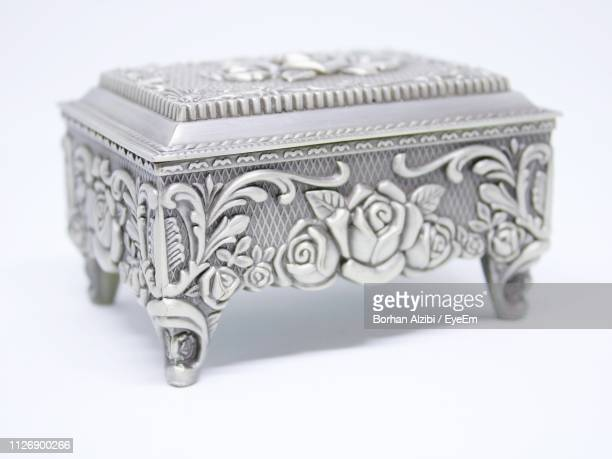close-up of antique jewelry box against white background - jewelry box stock pictures, royalty-free photos & images