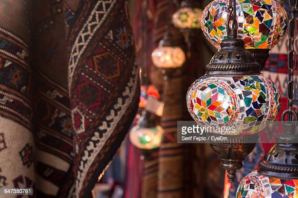 Close-Up Of Antique Lanterns At Temple