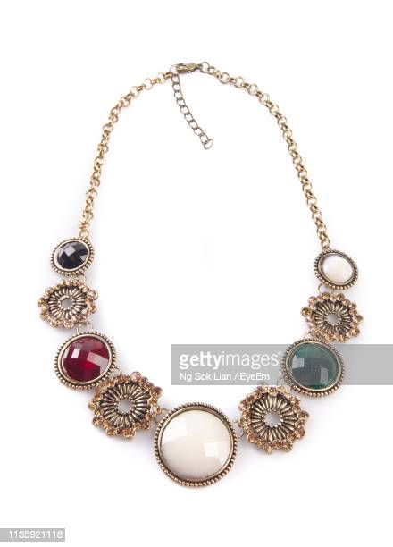 close-up of antique necklace on white background - collar fotografías e imágenes de stock