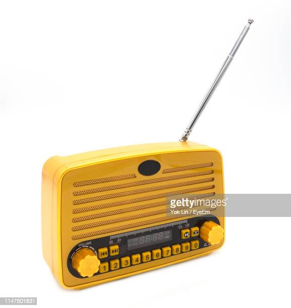 close-up of antique radio against white background - radio stock pictures, royalty-free photos & images
