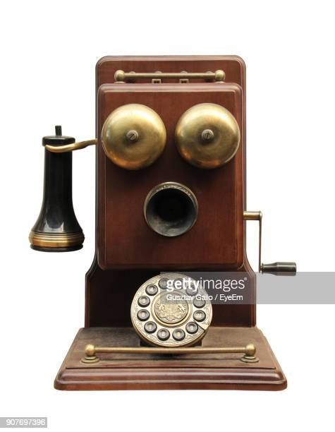 Close-Up Of Antique Telephone Over White Background