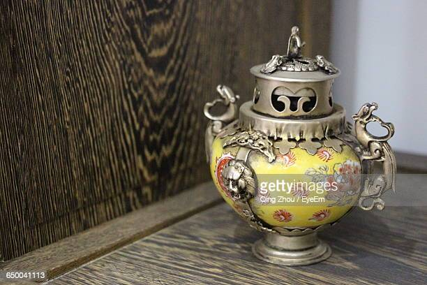 Close-Up Of Antique Urn On Table