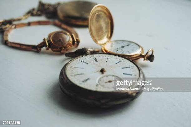 Close-Up Of Antique Watches On White Table