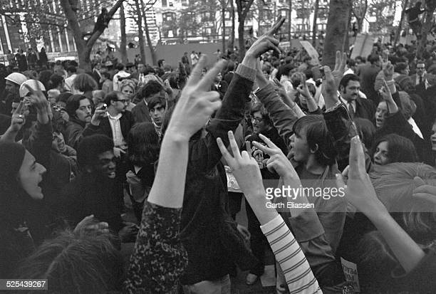 Closeup of antiwar demonstrators in Bryant Park hold up their fingers in 'Peace' signs as they protest the Vietnam War New York New York October 15...
