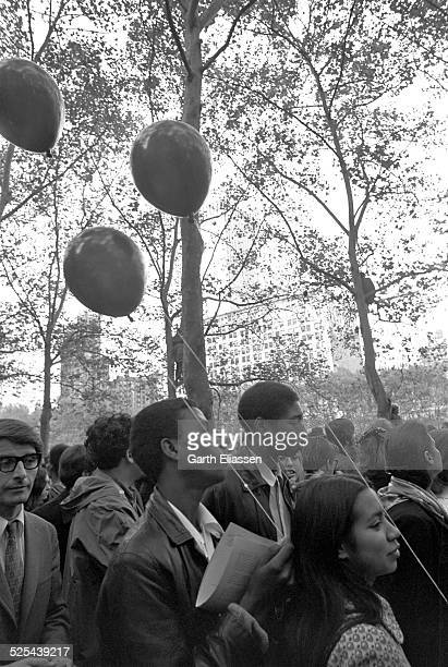 Closeup of antiwar demonstrators some with balloons in Bryant Park as they protest the Vietnam War New York New York October 15 1969 Tens of...