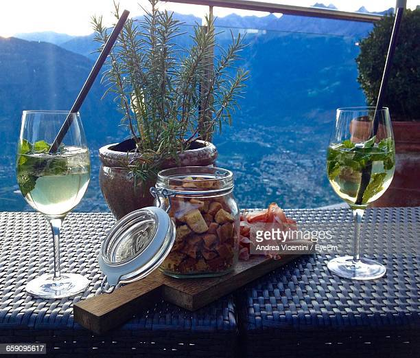 Close-Up Of Aperitif And Potted Plants By Jar On Table