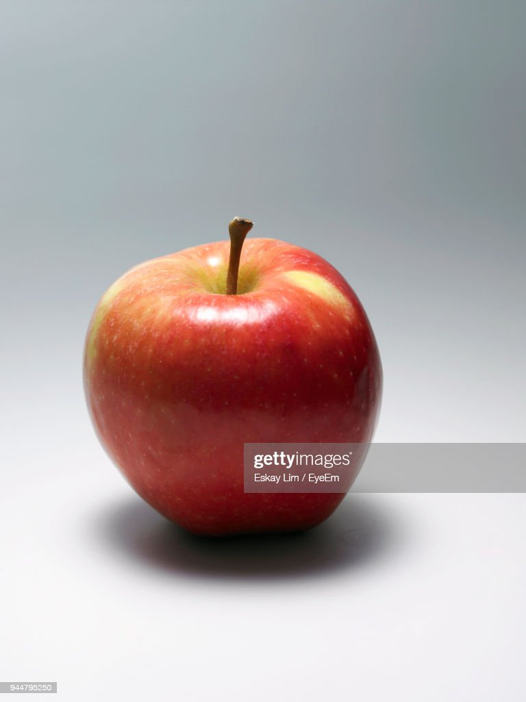 Close-Up Of Apple Against Gray Background : Stock Photo