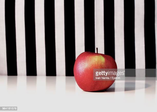 Close-Up Of Apple Against Striped Background
