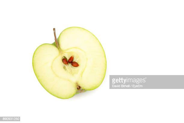 close-up of apple against white background - halved stock pictures, royalty-free photos & images