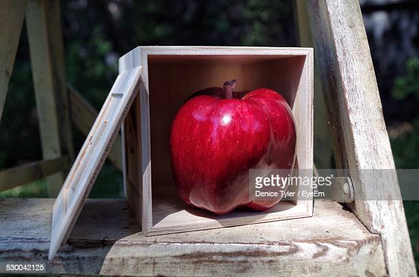 Close-Up Of Apple In Box On Table At Yard