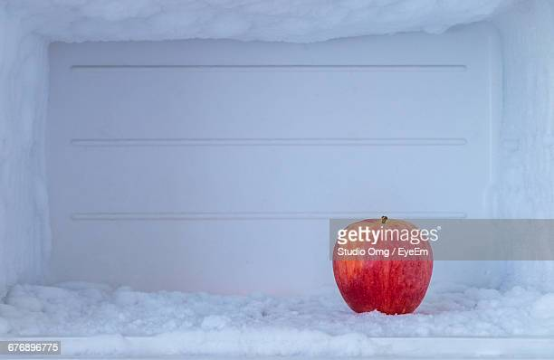 Close-Up Of Apple In Frozen Refrigerator