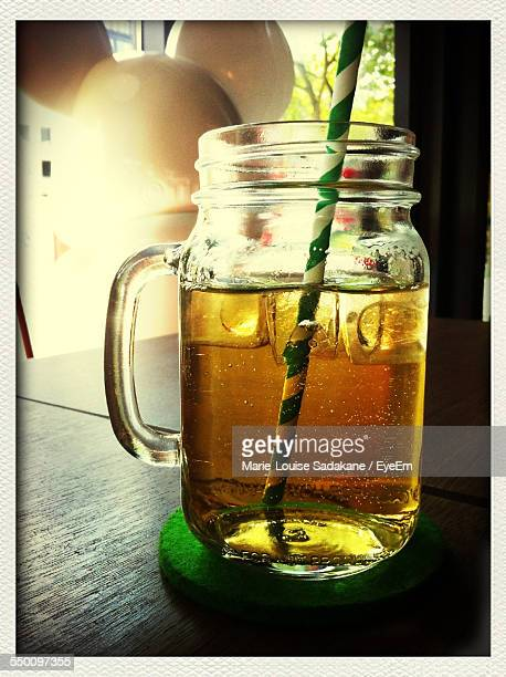 Close-Up Of Apple Juice Glass On Table