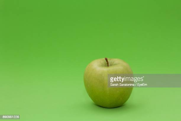 Close-Up Of Apple On Green Background