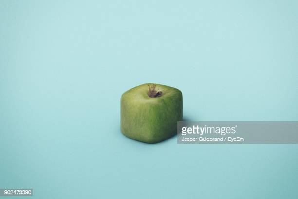 Close-Up Of Apple Over Blue Background