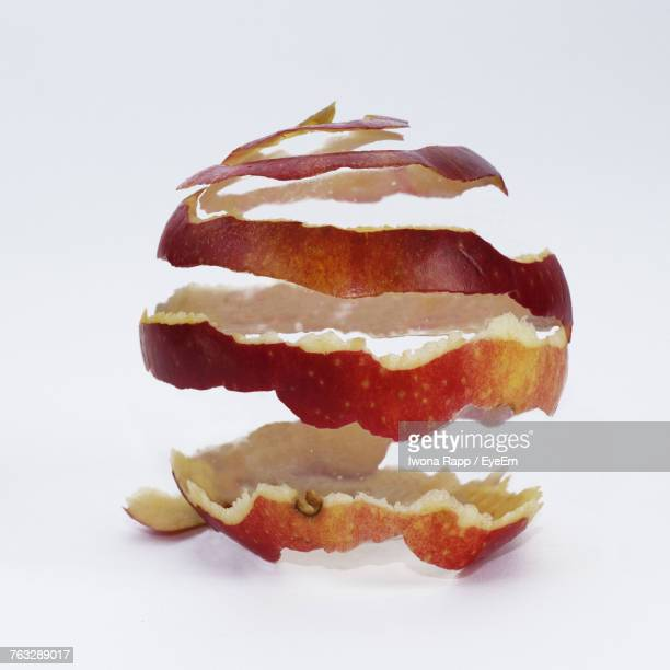 Close-Up Of Apple Peel Against White Background