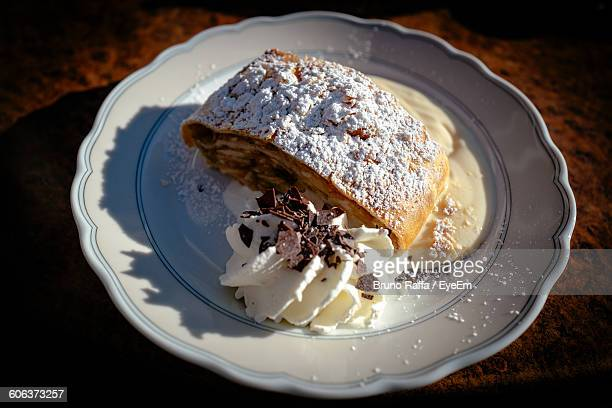Close-Up Of Apple Strudel And Ice Cream Served In Plate