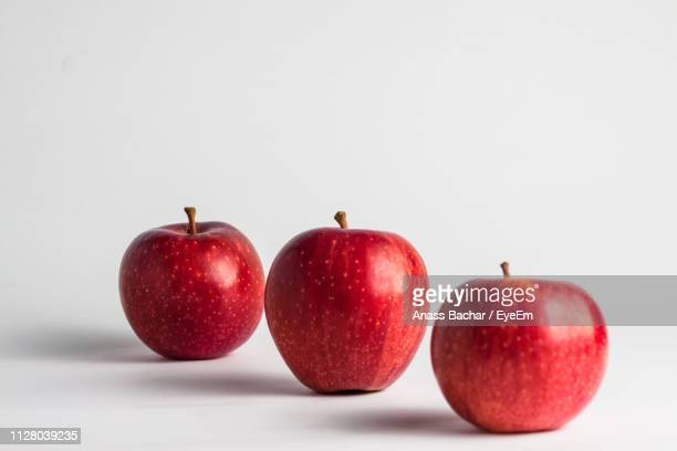 Close-Up Of Apples Against White Background