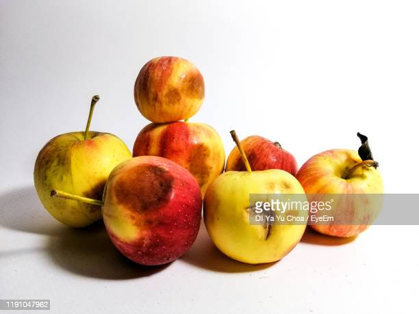close-up of apples against white background - rot stock pictures, royalty-free photos & images