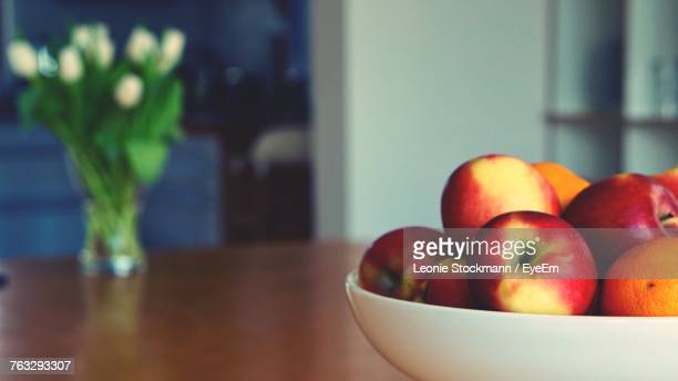 close-up of apples in bowl on table - fruit bowl stock pictures, royalty-free photos & images