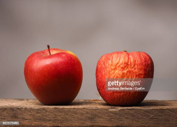 close-up of apples on table - rot stock pictures, royalty-free photos & images