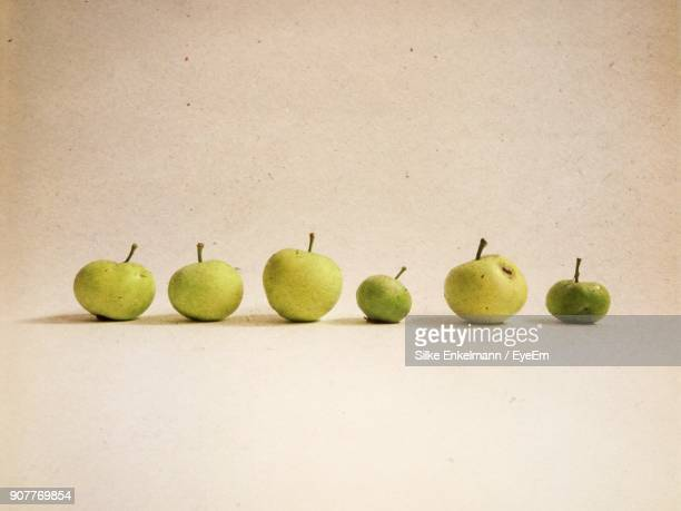 Close-Up Of Apples Over Beige Background