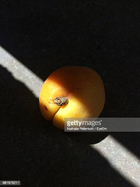 close-up of apricot on table - nathalie pellenkoft stock pictures, royalty-free photos & images