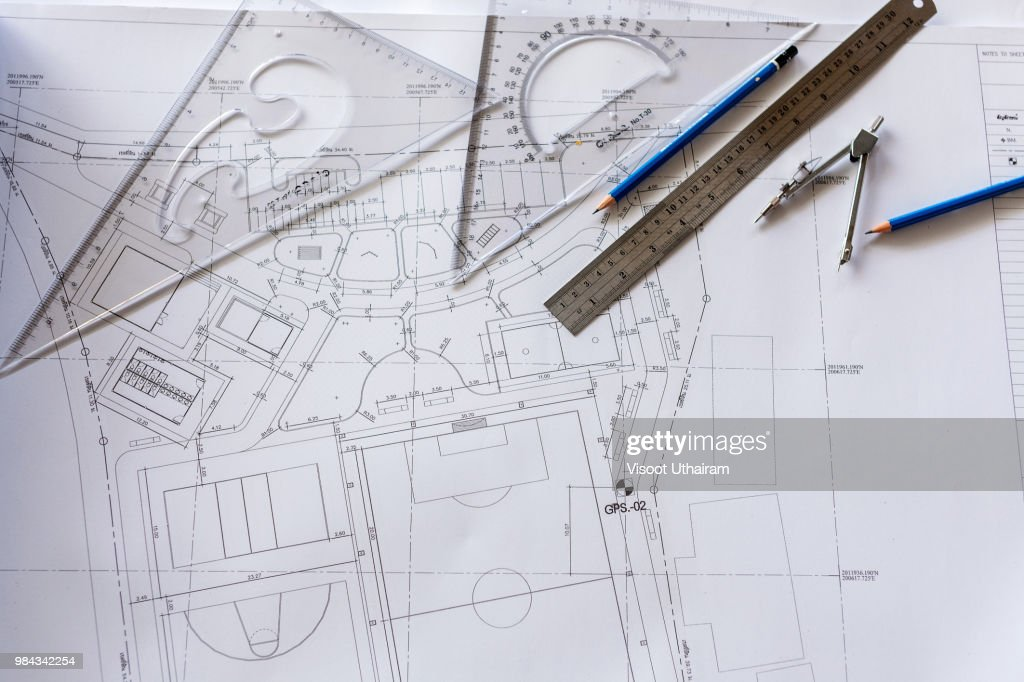 Close-up of Architect engineer drawing plan on blueprint with architect equipment : Stock Photo
