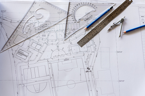Close-up of Architect engineer drawing plan on blueprint with architect equipment - gettyimageskorea