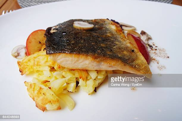Close-Up Of Arctic Char In Plate
