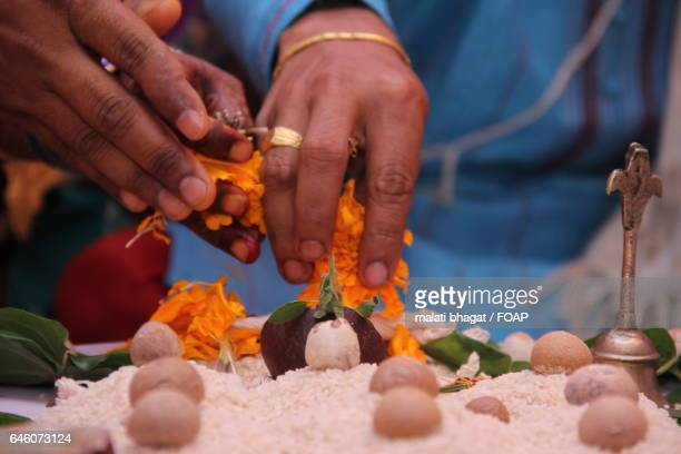 Close-up of areca nuts on rice during wedding ceremony